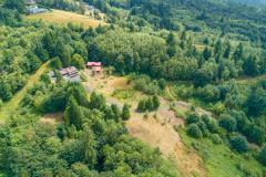 House and barn near the left